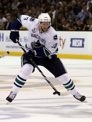 BOSTON, MA - JUNE 13:  Alexander Edler #23 of the Vancouver Canucks skates with the puck during Game Six of the 2011 NHL Stanley Cup Final at TD Garden on June 13, 2011 in Boston, Massachusetts.  (Photo by Elsa/Getty Images)