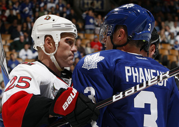 TORONTO, CANADA - SEPTEMBER 19: Dion Phaneuf #3 of the Toronto Maple Leafs roughs up Chris Neil #25of the Ottawa Senators during preseason NHL action at the Air Canada Centre September 19, 2011 in Toronto, Ontario, Canada. (Photo by Abelimages/Getty Image