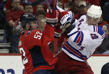 WASHINGTON, DC - APRIL 13: Mike Green #52 of the Washington Capitals hits Marian Gaborik #10 of the New York Rangers in Game One of the Eastern Conference Quarterfinals during the 2011 NHL Stanley Cup Playoffs at Verizon Center on April 13, 2011 in Washin