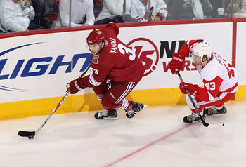 GLENDALE, AZ - APRIL 20:  Keith Yandle #3 of the Phoenix Coyotes skates with the puck in Game Four of the Western Conference Quarterfinals against the Detroit Red Wings during the 2011 NHL Stanley Cup Playoffs at Jobing.com Arena on April 20, 2011 in Glen
