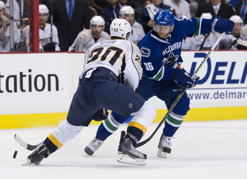 VANCOUVER, CANADA - MAY 7: Jannik Hansen #36 of the Vancouver Canucks tries to get past Ryan Suter #20 of the Nashville Predators during the third period in Game Five of the Western Conference Semifinals during the 2011 NHL Stanley Cup Playoffs on May 07,