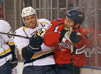 BALTIMORE, MD - SEPTEMBER 20: Shea Weber #6 of the Nashville Predators checks D.J. King #17 of the Washington Capitals at the 1st Mariner Arena on September 20, 2011 in Baltimore, Maryland.  (Photo by Bruce Bennett/Getty Images)