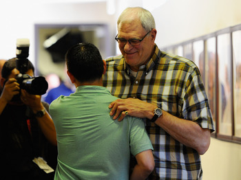 EL SEGUNDO, CA - MAY 11:  Phil Jackson, coach of the Los Angeles Lakers, hugs a Kevin Ding reporter for the Orange County Register as he leaves his last official Lakers news conference at the team's training facility on May 11, 2011 in El Segundo, Califor