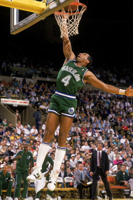 LOS ANGELES - 1989:  Adrian Dantley #4 of the Dallas Mavericks dunks the ball during the NBA game against the Los Angeles Lakers at the Great Western Forum in Los Angeles, California in 1989.  (Photo by Stephen Dunn/Getty Images)