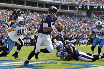 NASHVILLE, TN - SEPTEMBER 18:   Joe Flacco #5 of the Baltimore Ravens scrambles in the end zone to avoid the rush during a game against the Tennessee Titans at the LP Field on September 18, 2011 in Nashville, Tennessee.  The Titans defeated the Ravens 26