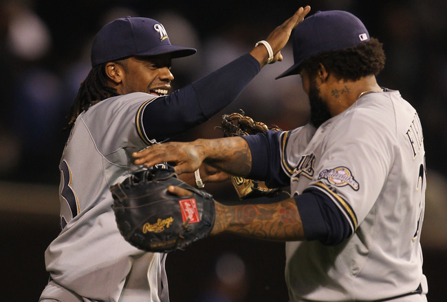 CHICAGO, IL - SEPTEMBER 20: Rickie Weeks #23 (L) and Prince Fielder #28 of the Milwaukee Brewers celebrate a win over the Chicago Cubs at Wrigley Field on September 20, 2011 in Chicago, Illinois. The Brewers defeated the Cubs 5-1.  (Photo by Jonathan Dani