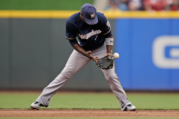 CINCINNATI, OH - SEPTEMBER 18:  Yuniesky Betancourt #3 of the Milwaukee Brewers commits an error in fielding a ground ball giving the Cincinnati Reds their first base runner of the game in the fourth inning at Great American Ball Park on September 18, 201