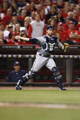 CINCINNATI, OH - SEPTEMBER 17:   Jonathan Lucroy #20 of the Milwaukee Brewers makes the play behind homeplate during the game against the Cincinnati Reds on September 17, 2011 at Great American Ball Park in Cincinnati, Ohio.  The Brewers defeated the Reds