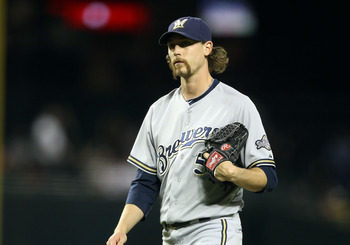 PHOENIX, AZ - JULY 20:  Relief pitcher John Axford #59 of the Milwaukee Brewers during the Major League Baseball game against the Arizona Diamondbacks at Chase Field on July 20, 2011 in Phoenix, Arizona. The Brewers defeated the Diamondbacks 5-2 in 10 inn