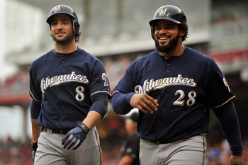 CINCINNATI, OH - SEPTEMBER 18:  Ryan Braun #8 of the Milwaukee Brewers and Prince Fielder #28 of the Milwaukee Brewers walk back to the dugout after they both scored runs in the second inning against the Cincinnati Reds at Great American Ball Park on Sept
