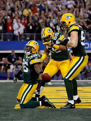 ARLINGTON, TX - FEBRUARY 06:  (L-R) Nick Collins #36, Desmond Bishop #55 and Clay Matthews #52 of the Green Bay Packers celebrate after Collins scored a touchdown on an interception return against the Pittsburgh Steelers during Super Bowl XLV at Cowboys S