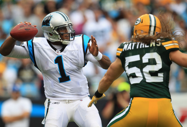 CHARLOTTE, NC - SEPTEMBER 18:  Clay Matthews #52 against Cam Newton #1 of the Carolina Panthers during their game at Bank of America Stadium on September 18, 2011 in Charlotte, North Carolina.  (Photo by Streeter Lecka/Getty Images)