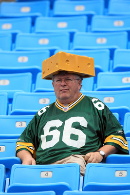 Dedication:  Sitting in a football stadium with a cheesehead on.