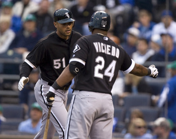 KANSAS CITY, MO - SEPTEMBER 17:   Alex Rios #51 of the Chicago White Sox celebrates his home run with Dayan Viciedo #24 in the second inning during a game against the Kansas City Royals at Kauffman Stadium on September 17, 2011 in Kansas City, Missouri. (