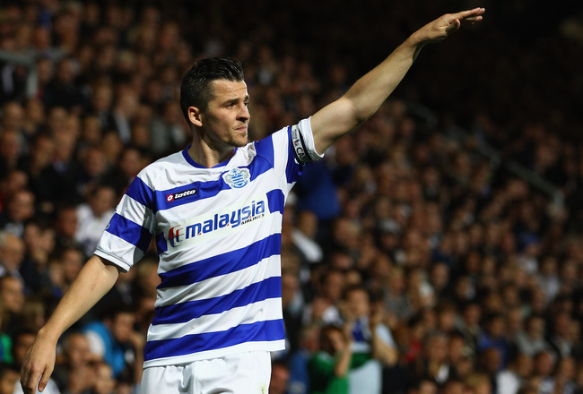 LONDON, ENGLAND - SEPTEMBER 12:  Joey Barton of QPR gives instructions during the Barclays Premier League match between Queens Park Rangers and Newcastle United at Loftus Road on September 12, 2011 in London, England.  (Photo by Julian Finney/Getty Images