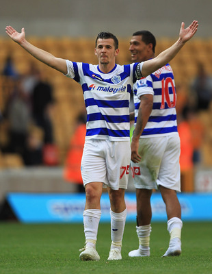 WOLVERHAMPTON, ENGLAND - SEPTEMBER 17:  Joey Barton of Queens Park Rangers celebrates his teams win during the Barclays Premier League match between Wolverhampton Wanderers and Queens Park Rangers at Molineux on September 17, 2011 in Wolverhampton, Englan