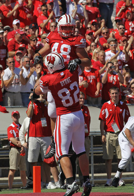 MADISON, WI - SEPTEMBER 10: Jacob Pedersen #48 of the Wisconsin Badgers is lifted by teammate Jake Byrne #82 after scoring a touchdown against the Oregon State Beavers at Camp Randall Stadium on September 10, 2011 in Madison Wisconsin. Wisconsin defeated