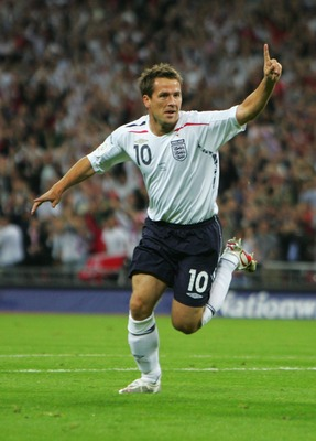 LONDON - SEPTEMBER 12:  Michael Owen of England celebrates as he scores their first goal during the Euro 2008 qualifying match between England and Russia at Wembley Stadium on September 12, 2007 in London, England.  (Photo by Laurence Griffiths/Getty Imag
