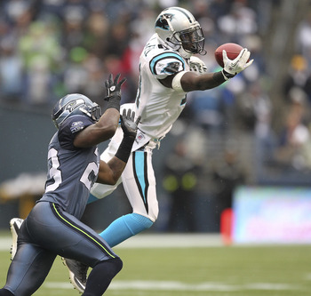 SEATTLE, WA - DECEMBER 05:  Wide receiver Brandon LaFell #11 of the Carolina Panthers just misses this pass against Marcus Trufant #23 of the Seattle Seahawks at Qwest Field on December 5, 2010 in Seattle, Washington. (Photo by Otto Greule Jr/Getty Images
