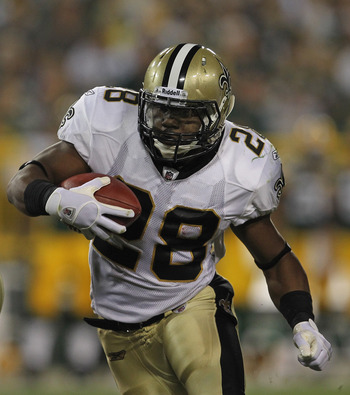 GREEN BAY, WI - SEPTEMBER 08:  Mark Ingram #28 of the New Orleans Saints runs against the Green Bay Packers during the NFL opening season game at Lambeau Field on September 8, 2011 in Green Bay, Wisconsin. The Packers defeated the Saints 42-34.  (Photo by