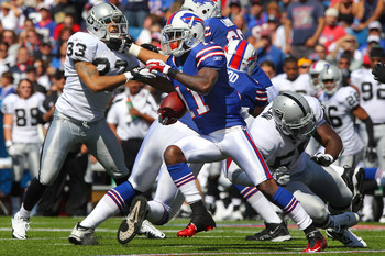 ORCHARD PARK, NY - SEPTEMBER 18: Roscoe Parrish #11 of the Buffalo Bills rushes after catching a pass during an NFL game against the Oakland Raiders at Ralph Wilson Stadium on September 18, 2011 in Orchard Park, New York. (Photo by Tom Szczerbowski/Getty