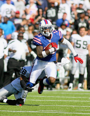 ORCHARD PARK, NY - SEPTEMBER 18: Steve Johnson #13 of the Buffalo Bills runs after a catch against Stanford Routt #26 of the Oakland Raiders at Ralph Wilson Stadium on September 18, 2011 in Orchard Park, New York.  (Photo by Rick Stewart/Getty Images)