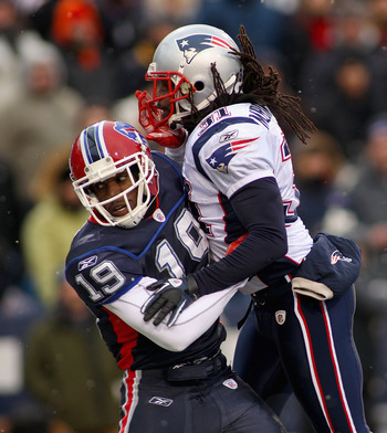 ORCHARD PARK, NY - DECEMBER 26: Donald Jones #19 of the Buffalo Bills is hit by Brandon Meriweather #31 of the New England Patriots at Ralph Wilson Stadium on December 26, 2010 in Orchard Park, New York. New England won 34-3. (Photo by Rick Stewart/Getty