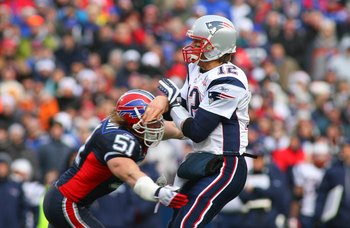 ORCHARD PARK, NY - DECEMBER 20: Tom Brady #12 of the New England Patriots throws a pass as  Paul Posluszny #51 of the Buffalo Bills defends during the game at Ralph Wilson Stadium on December 20, 2009 in Orchard Park, New York. (Photo by: Rick Stewart/Get