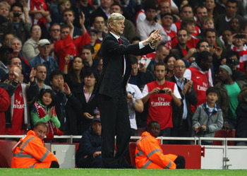 LONDON, ENGLAND - SEPTEMBER 20:  Arsene Wenger manager of Arsenal signals during the Carling Cup Third Round match between Arsenal and Shrewsbury Town at Emirates Stadium on September 20, 2011 in London, England.  (Photo by Julian Finney/Getty Images)