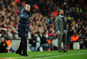 BARCELONA, SPAIN - APRIL 06:  Manager of Arsenal Arsene Wenger and manager of Barcelona Josep Guardiola react on the touchline during the UEFA Champions League quarter final second leg match between Barcelona and Arsenal at Camp Nou on April 6, 2010 in Ba