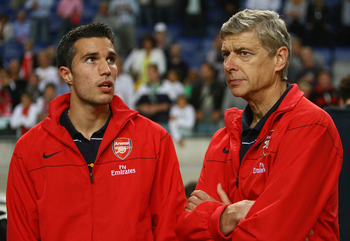 AMSTERDAM, NETHERLANDS - AUGUST 09:  Robin Van Persie and Arsenal manager Arsene Wenger after Arsenal win the Amsterdam Tournament match between Ajax and Inter Milan at the Amsterdam Arena on August 9, 2008 in Amsterdam, Netherlands.  (Photo by Ian Walton