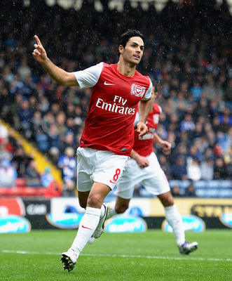 BLACKBURN, ENGLAND - SEPTEMBER 17: Mikel Arteta of Arsenal celebrates the second goal during the Barclays Premier League match between Blackburn Rovers and Arsenal at Ewood Park on September 17, 2011 in Blackburn, England.  (Photo by Laurence Griffiths/Ge