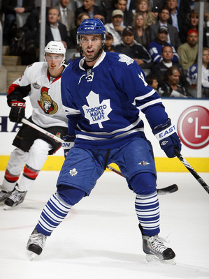 TORONTO, CANADA - SEPTEMBER 19: Philipps Dupuis #11 of the Toronto Maple Leafs takes to the ice the first time against the Ottawa Senators during preseason NHL action at the Air Canada Centre September 19, 2011 in Toronto, Ontario, Canada. (Photo by Abeli