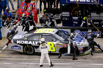 JOLIET, IL - SEPTEMBER 19:  Jimmie Johnson, driver of the #48 Lowe's/Kobalt Tools Chevrolet, pits during the NASCAR Sprint Cup Series GEICO 400 at Chicagoland Speedway on September 19, 2011 in Joliet, Illinois.  (Photo by Scott Olson/Getty Images)