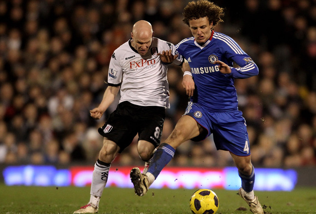 LONDON, ENGLAND - FEBRUARY 14:  David Luiz of Chelsea fights for the ball with Andrew Johnson of Fulham during the Barclays Premier League match between Fulham and Chelsea at Craven Cottage on February 14, 2011 in London, England.  (Photo by Scott Heavey/