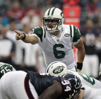 HOUSTON - AUGUST 15:  Quarterback Mark Sanchez #6 of the New York Jets calls out a play at the line of scrimmage against the Houston Texans in the first quarter at Reliant Stadium on August 15, 2011 in Houston, Texas.  (Photo by Bob Levey/Getty Images)