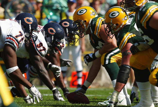 GREEN BAY, WI - SEPTEMBER 19:  The offensive line of the Green Bay Packers lines up against the defensive line of the Chicago Bears before the snap during the game on September 19, 2004 at Lambeau Field in Green Bay, Wisconsin. The Bears defeated the Pack