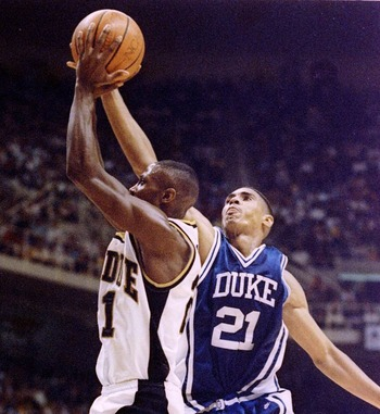 26 MARCH 1994:  DUKE''S ANTONIO LANG GETS A PIECE OF A SHOT BY PURDUE''S HERB DOVE DURING SECOND HALF ACTION IN THE NCAA SOUTHEAST REGIONAL  CHAMPIONSHIP. DUKE WON 69-60 AND ADVANCES TO THE FINAL FOUR IN CHARLOTTE, NORTH CAROLINA.   Mandatory Credit: Doug