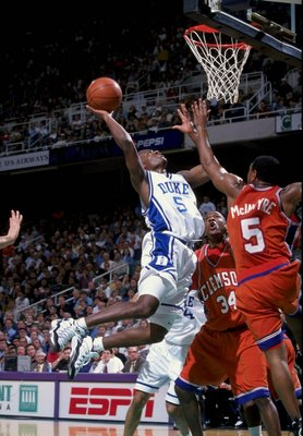 7 Mar 1998: Guard William Avery of the Duke Blue Devils (left) in action against guard Terrell McIntyre of the Clemson Tigers during an ACC Tournament game at the Greensboro Coliseum in Greensboro, North Carolina. Duke defeated Clemson 66-64.