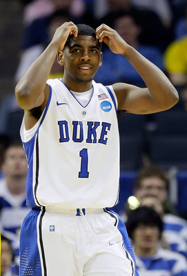 CHARLOTTE, NC - MARCH 20:  Kyrie Irving #1 of the Duke Blue Devils reacts while taking on the Michigan Wolverines in the second half during the third round of the 2011 NCAA men's basketball tournament at Time Warner Cable Arena on March 20, 2011 in Charlo