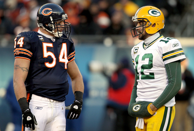 CHICAGO, IL - JANUARY 23:  Linebacker Brian Urlacher #54 of the Chicago Bears talks with quarterback Aaron Rodgers #12 of the Green Bay Packers in the second half of the NFC Championship Game at Soldier Field on January 23, 2011 in Chicago, Illinois.  (Ph