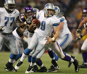 MINNEAPOLIS - NOVEMBER 15:  Matthew Stafford #9  of the Detroit Lions scrambles in the fourth quarter as Jared Allen #69  of the Minnesota Vikings pressures on November 15, 2009 at Hubert H. Humphrey Metrodome in Minneapolis, Minnesota. The Vikings defeat