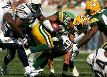 GREEN BAY, WI - SEPTEMBER 23:  Tramon Williams #38 of the Green Bay Packers looses his helmet while returning a kickoff against the San Diego Chargers at Lambeau Field September 23, 2007 in Green Bay, Wisconsin.  (Photo by Matthew Stockman/Getty Images)