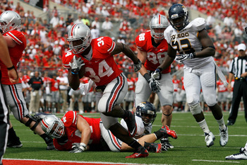 COLUMBUS, OH - SEPTEMBER 10:  Carlos Hyde #34 of the Ohio State Buckeyes scores the game winning touchdown during the third quarter against the Toledo Rockets on September 10, 2011 at Ohio Stadium in Columbus, Ohio. Ohio State defeated Toledo 27-22. (Phot