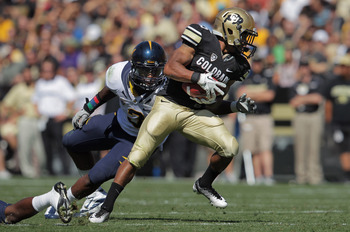 BOULDER, CO - SEPTEMBER 10:  Rodney Stewart #5 of the Colorado Buffaloes makes a first down reception against the defense of D.J. Holt #3 of the California Golden Bears at Folsom Field on September 10, 2011 in Boulder, Colorado.  (Photo by Doug Pensinger/