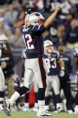 FOXBORO, MA - SEPTEMBER 18:   Tom Brady #12 of the New England Patriots celebrates the two point conversion in the fourth quarter against the San Diego Chargers on September 18, 2011 at Gillette Stadium in Foxboro, Massachusetts.  (Photo by Elsa/Getty Ima