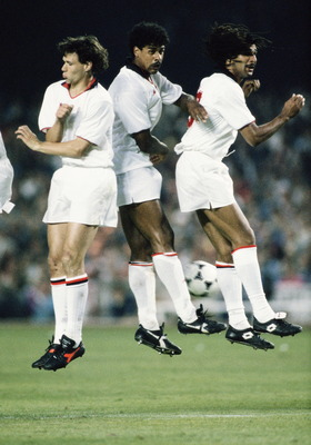 24 May 1989: Marco Van Basten (left) Frank Rijkaard and Ruud Gullit (right) of AC Milan on 24 May 1989 jump in the air during the European Cup Final match against Steaua Bucuresti at the Nou Camp Stadium in Barcelona, Spain. AC Milan won the match 4-0.  (