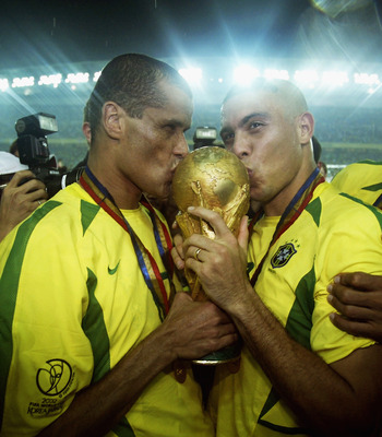 YOKOHAMA - JUNE 30:  Rivaldo and Ronaldo of Brazil kiss the trophy after the Germany v Brazil, World Cup Final match played at the International Stadium Yokohama in Yokohama, Japan on June 30, 2002. Brazil won 2-0. (Photo by Alex Livesey/Getty Images)