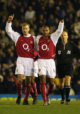 BIRMINGHAM - JANUARY 12:  Thierry Henry of Arsenal celebrates scoring his 100th goal for Arsenal with Dennis Bergkamp of Arsenal during the FA Barclaycard Premiership match between Birmingham City and Arsenal held on January 12, 2003 at St Andrews in Birm
