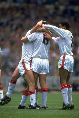 1990:  Bryan Robson #8 and Paul Ince #2 of Manchester United celebrate with their team mate during the FA Cup final against Crystal Palace at Wembley Stadium in London. The match ended in a 3-3 draw.  \ Mandatory Credit: Russell  Cheyne/Allsport